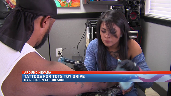 Local tattoo delivers hundreds of toys to kids in Reno for the ...